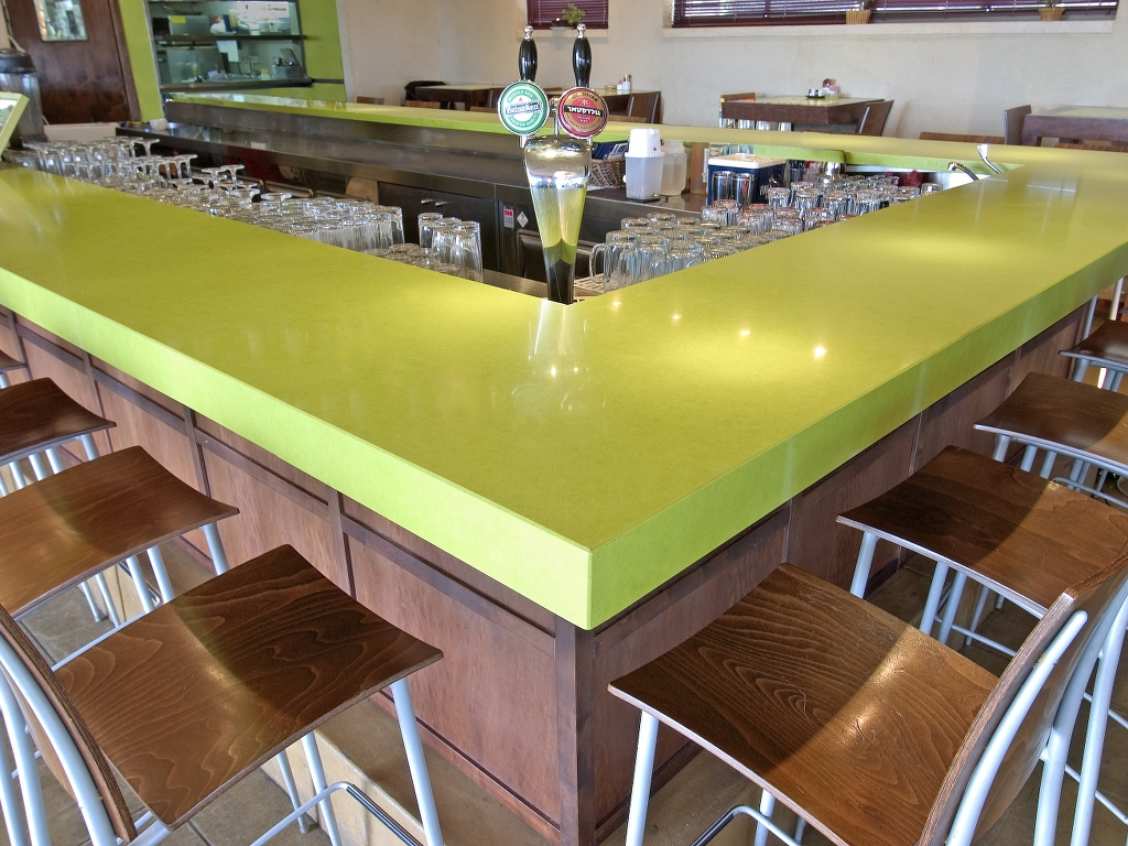 greenyellow Caesarstone Capitol Granite bar table top plus chairs with wooden seat for bar space ideas
