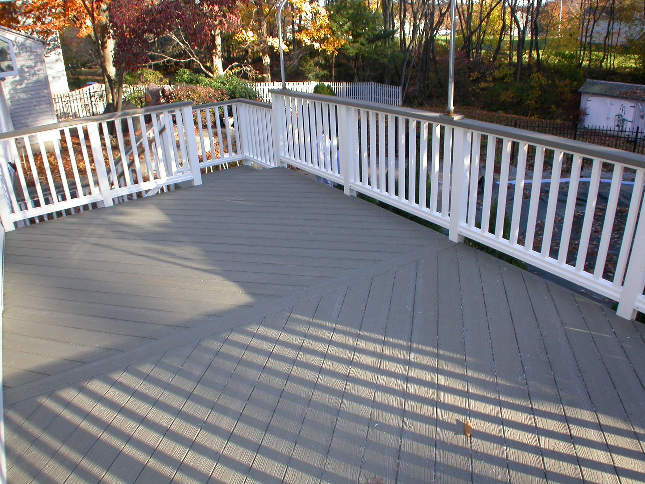 grey evergrain decking matched with white railing for deck ideas