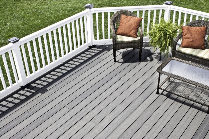 Grey Evergrain Decking Matched With White Railing Plus Rattan Sofa Set Plus Cushion For Patio Ideas