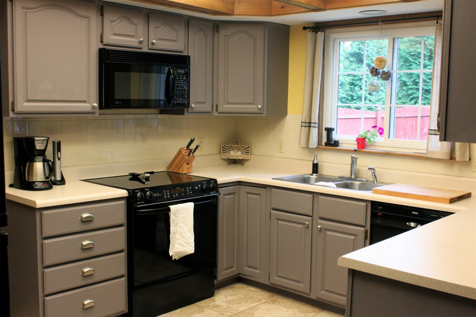 grey kitchen cabinet refacing plus black oven and sink with kitchen faucet under slider window for beautiful kitchen ideas