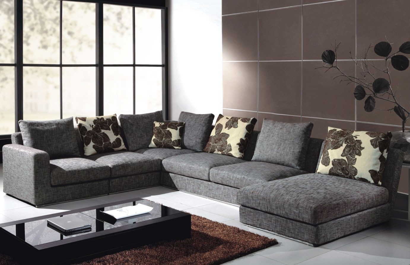 grey Leather Sectional Couches With cushions on white ceramic floor plus brown carpet for inspiring living room decor ideas