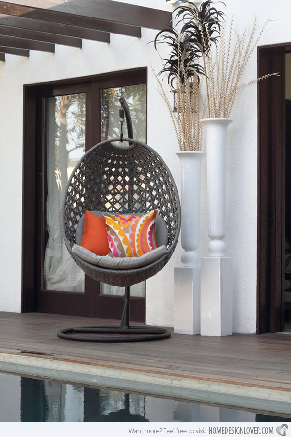 grey Swingasan Chair with colorful cushion on wooden floor