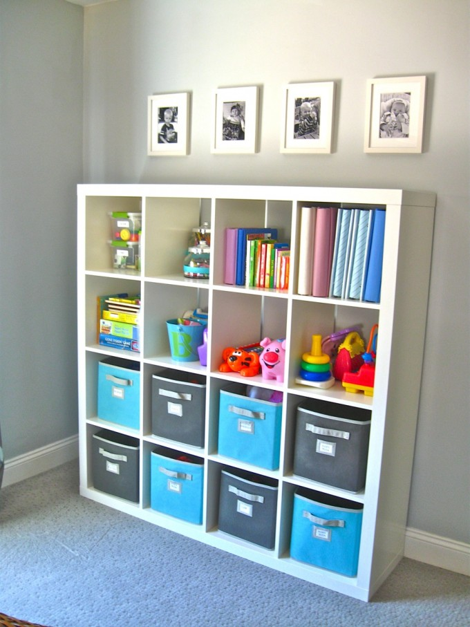 Ikea Expedit Bookcase Filled With Books And Toys Plus Some Boxes Ideas Before The Grey Wall And Pictures