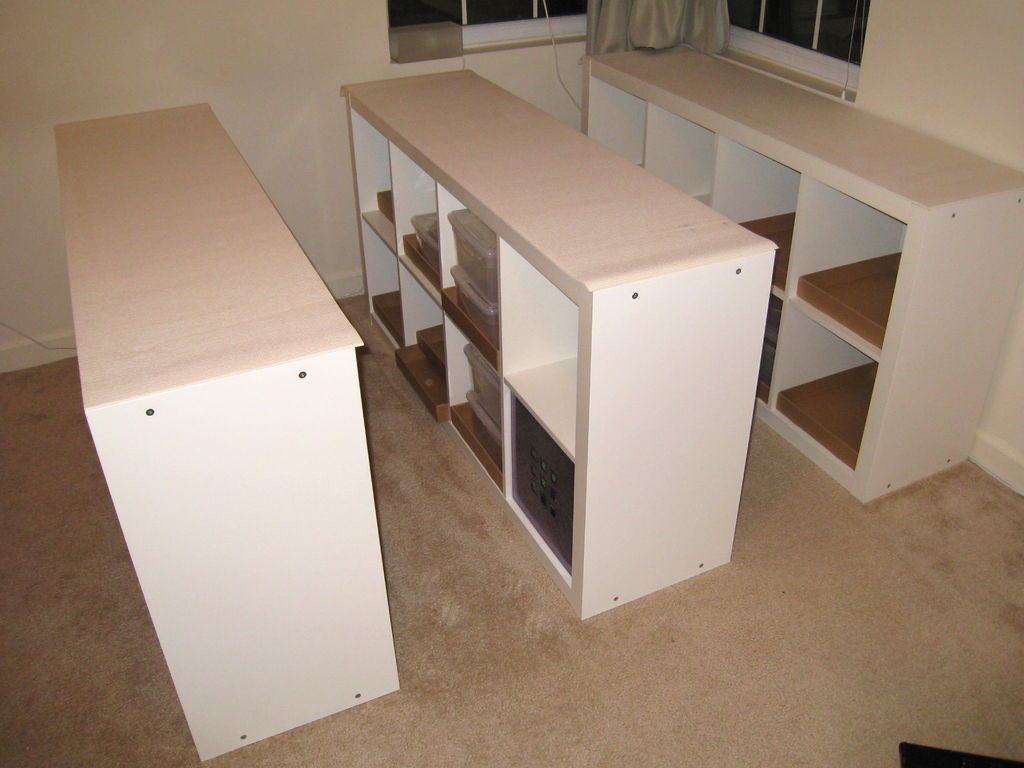 ikea Expedit Bookcase in white with white wall and cream floor