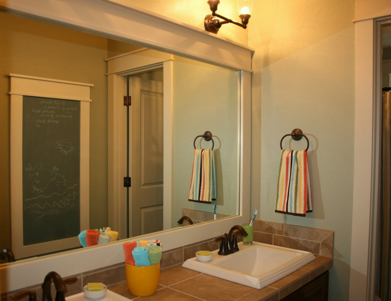 inspiring bathroom with lowes bathroom ligting plus mirror and towel hanger plus sink ideas