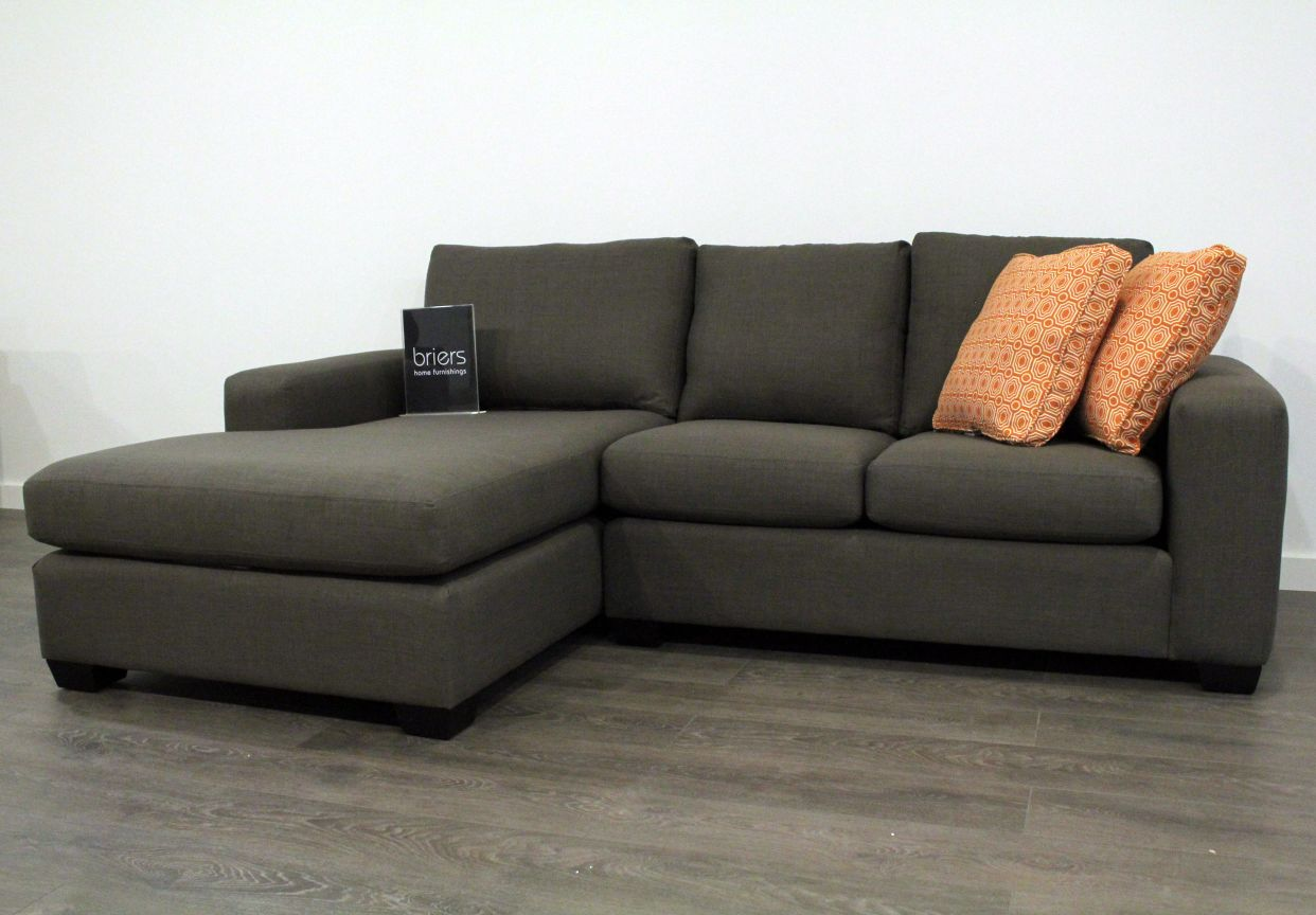 inspiring black Sectional Couches plus orange cushions for inspiring living room furniture ideas