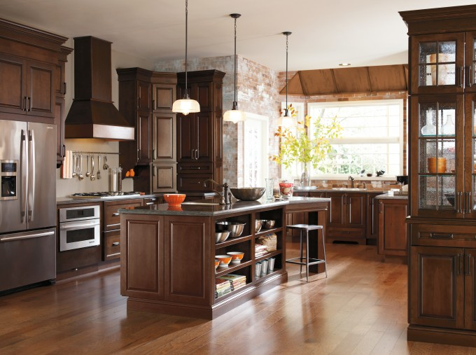 Inspiring Brown Aristokraft Cabinets Matched With Wooden Floor Plus Oven And Chimney For Inspiring Kitchen Ideas