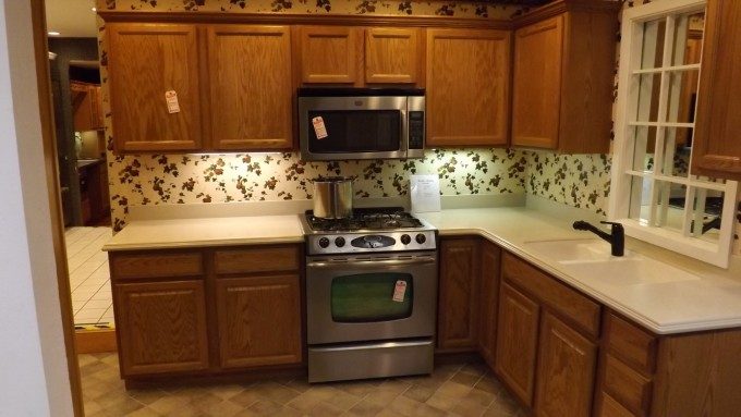 Inspiring Kitchen Ideas With Brown Merillat Cabinets With White Countertop Plus Oven And White Sink With Black Kitchen Faucet