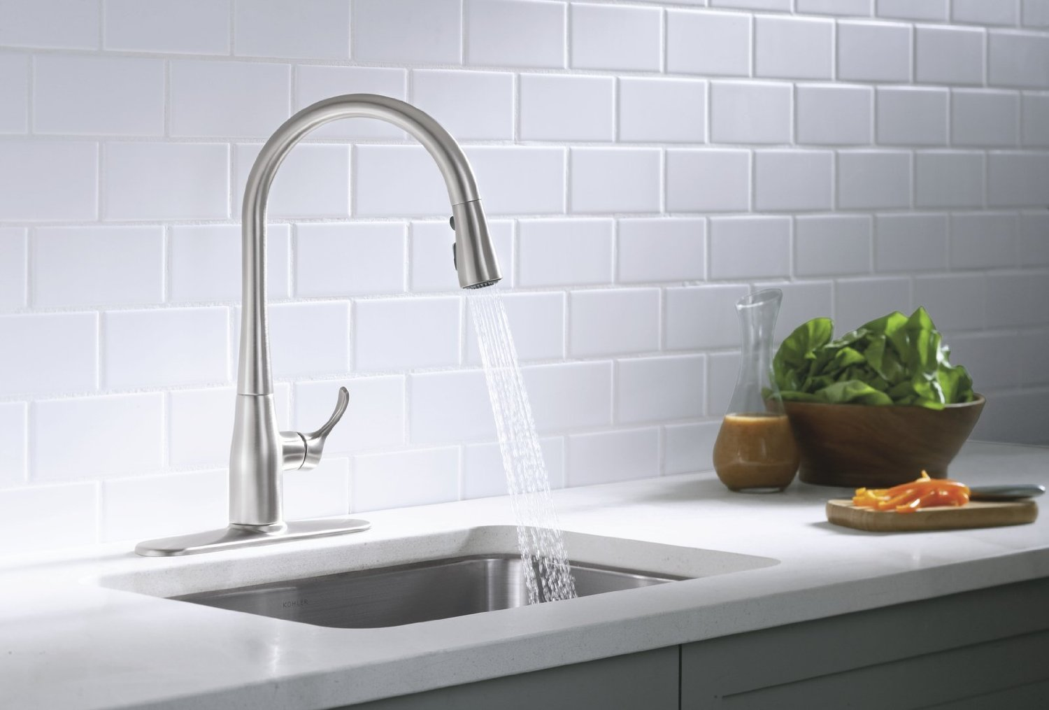 inspiring kitchen with kohler sinks and faucet plus white bricked wall