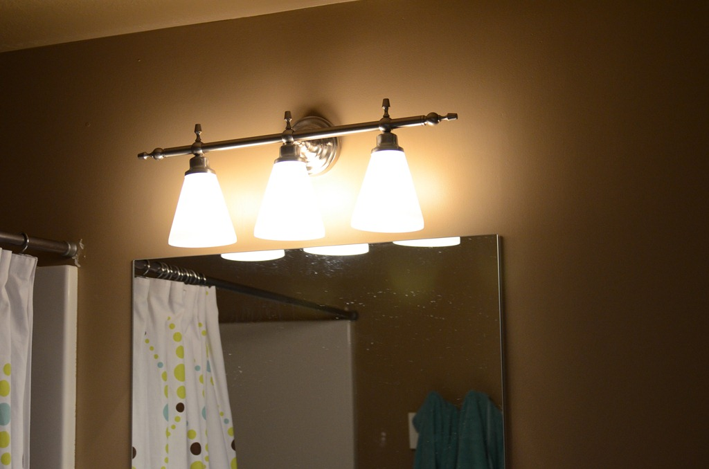 inspiring lowes bathroom lighting above the mirror for bathroom decor ideas