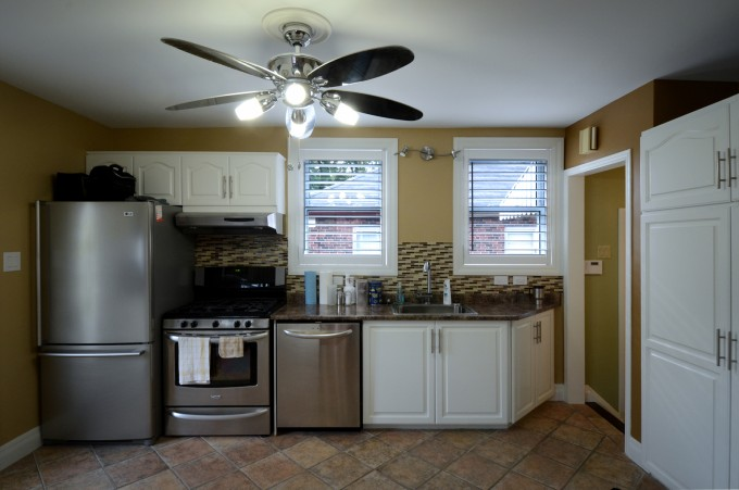 Kitchen Cabinet Refacing In White Plus Oven And Frige With White Window Plus Ceiling Fan With Light