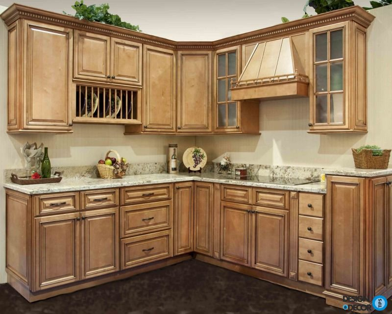 latte Aristokraft Cabinets With wheat countertop and white wall and dark brown floor for kitchen decor ideas