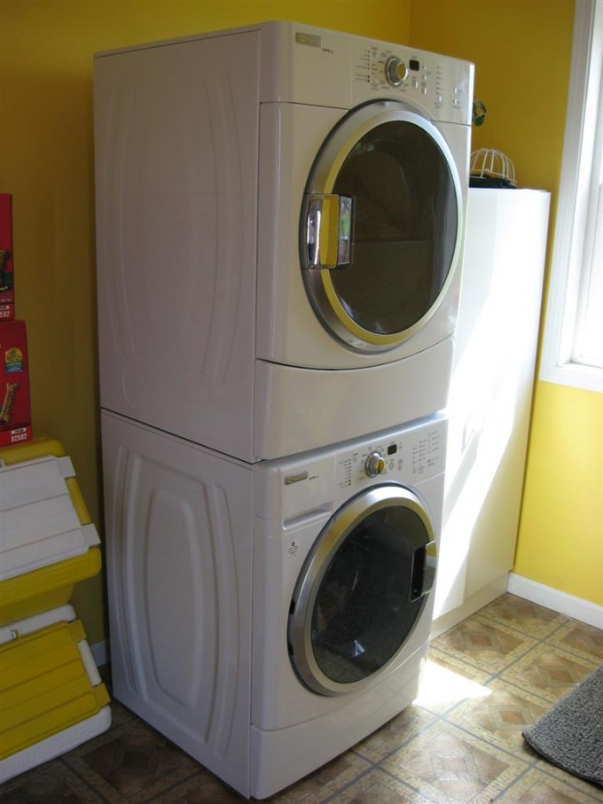 Laundry Room Decor With White Stackable Washer And Dryer And Yellow Wall Ideas