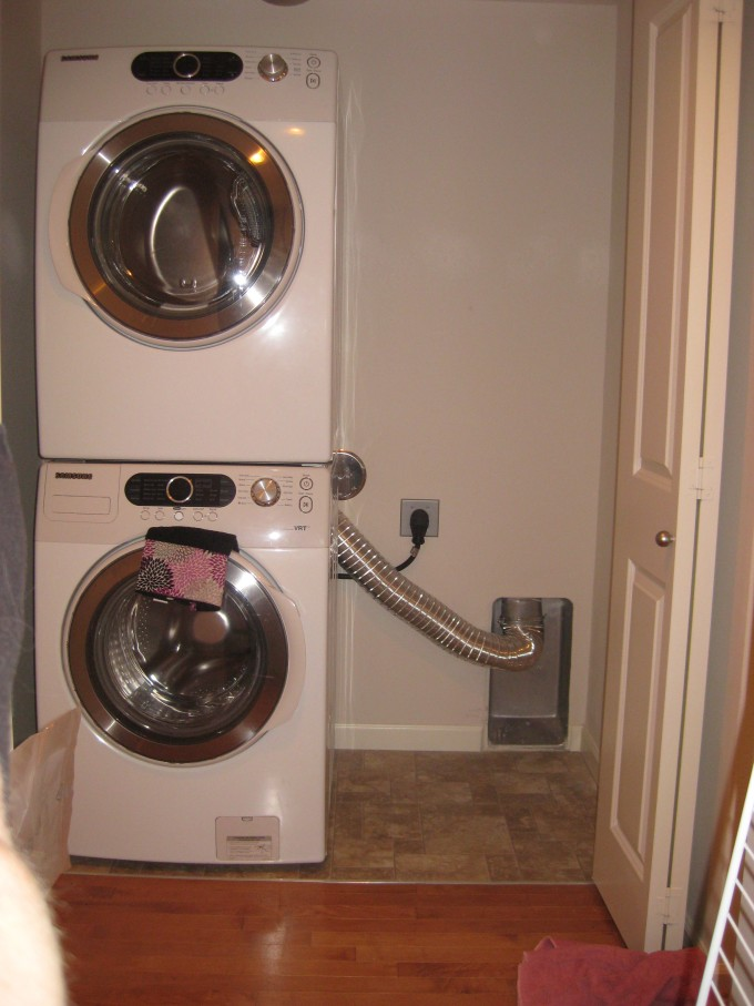 Laundry Room Decor With White Stackable Washer And Dryer Plus Tan Ceramic Floor Ideas