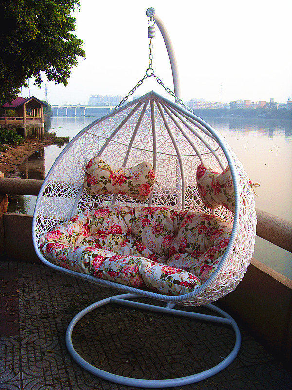 lovely white wicker rattan Swingasan chair with floral cushion and white stand ideas