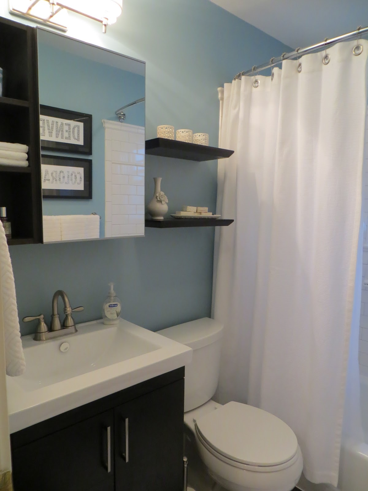 Lowes medicine cabinets with mirror surface on bathroom with blue wall plus white sink and silver faucet plus white curtains