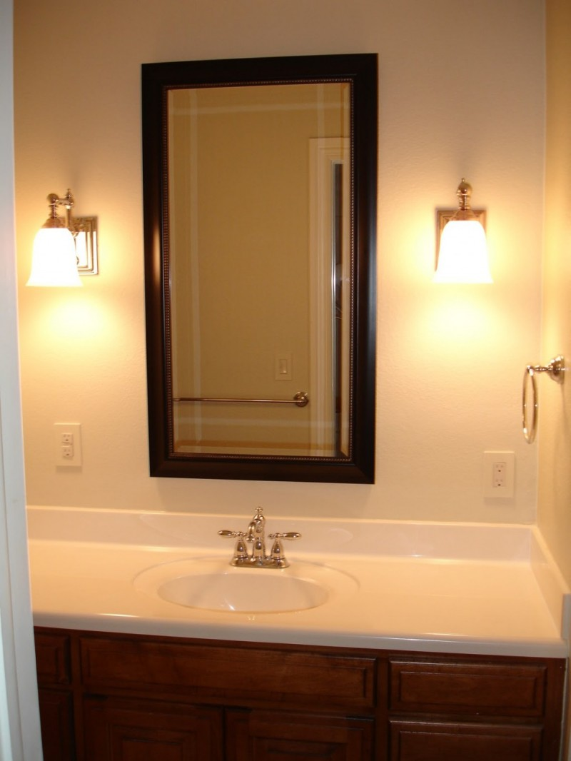 Marvelous Bathroom with double lowes bathroom lighting on white wall plus a picture mirror and a white sink ideas