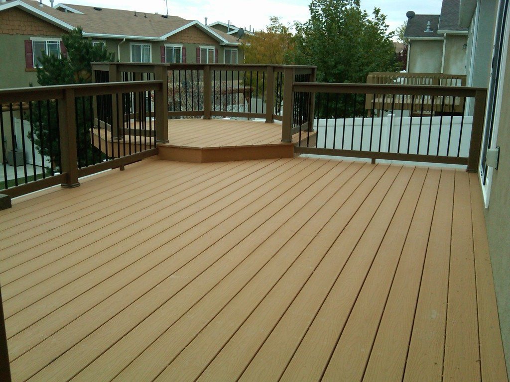 mocca evergrain decking matched with tan railing for deck ideas