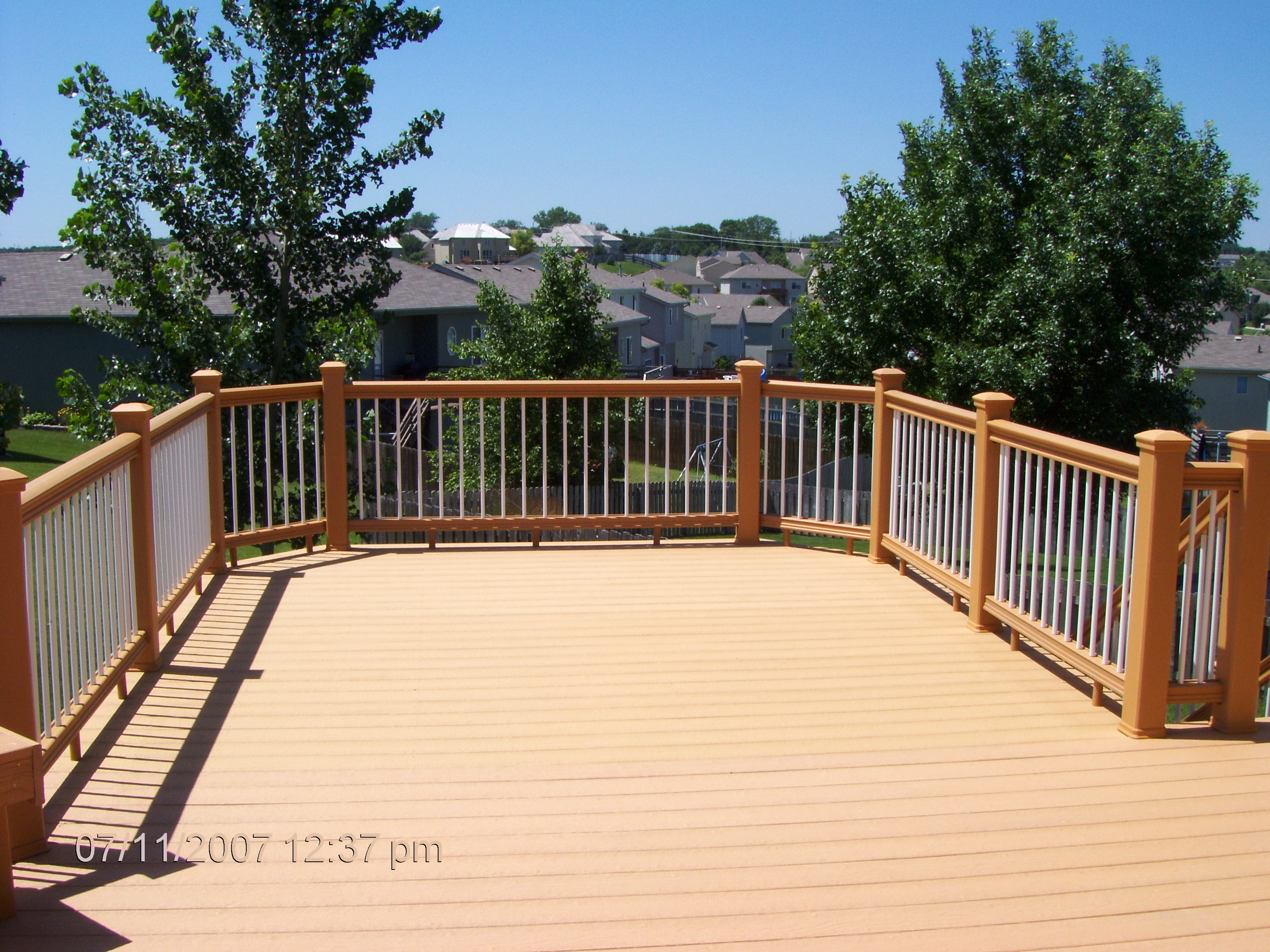 mocca evergrain decking matched with white and goldenrod railing for patio ideas