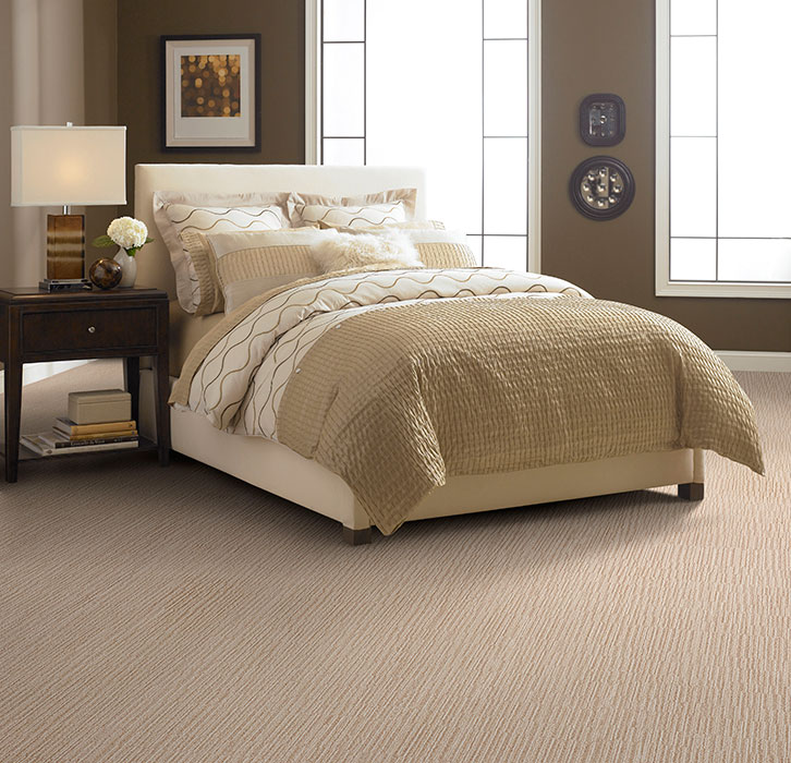 mocca masland carpet with tan bedding plus table standing lamp ideas