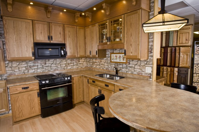 Mocca Merillat Cabinets Plus Black Oven Plus Chandelier And Black Chairs For Kitchen Ideas