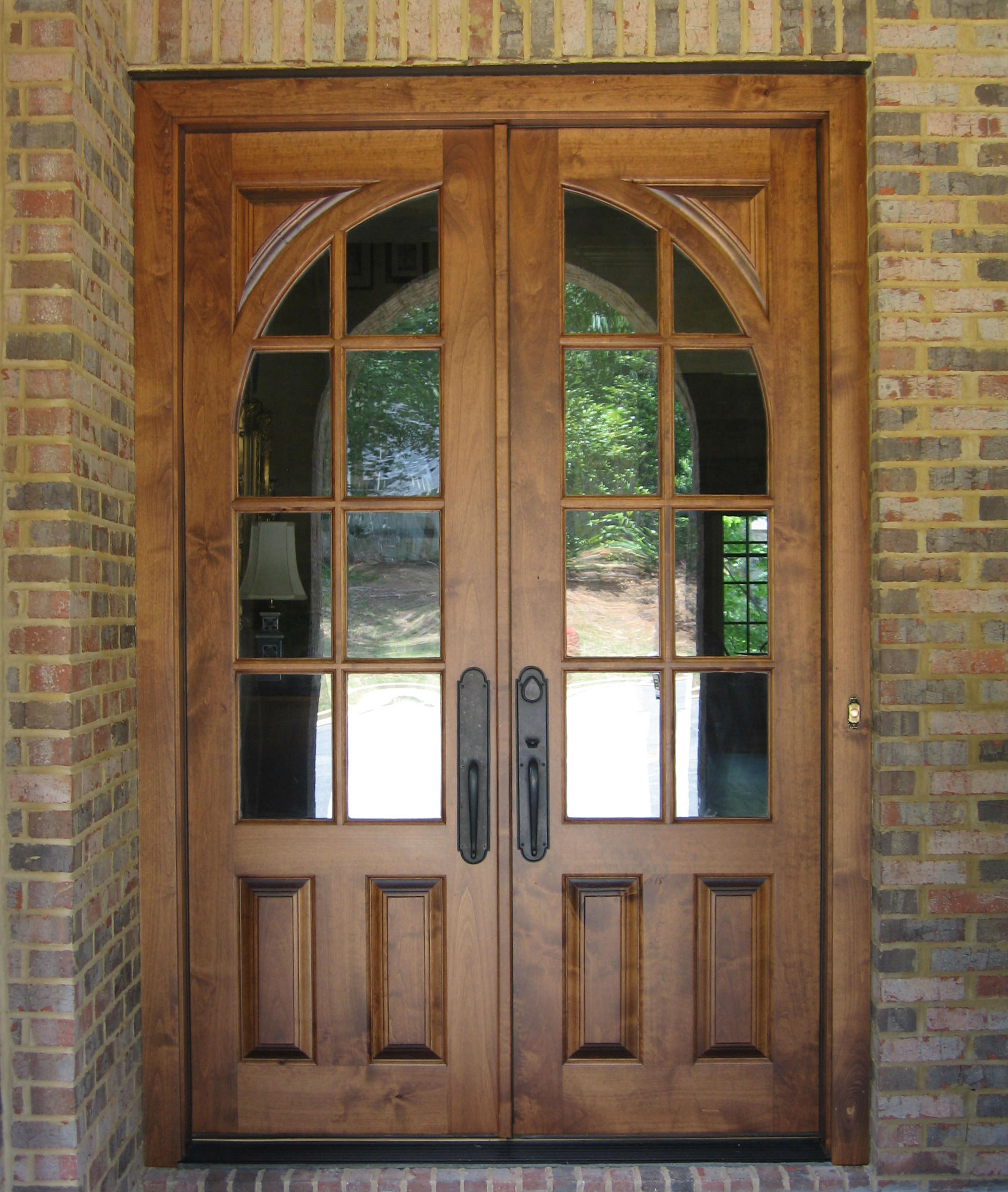 mocca therma tru entry doors with black handle matched with brick wall ideas
