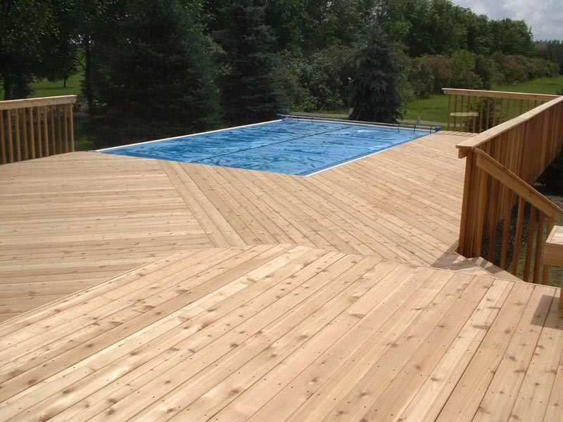 moccasin Evergrain decking matched with mocca railin plus swimming pool for best patio ideas