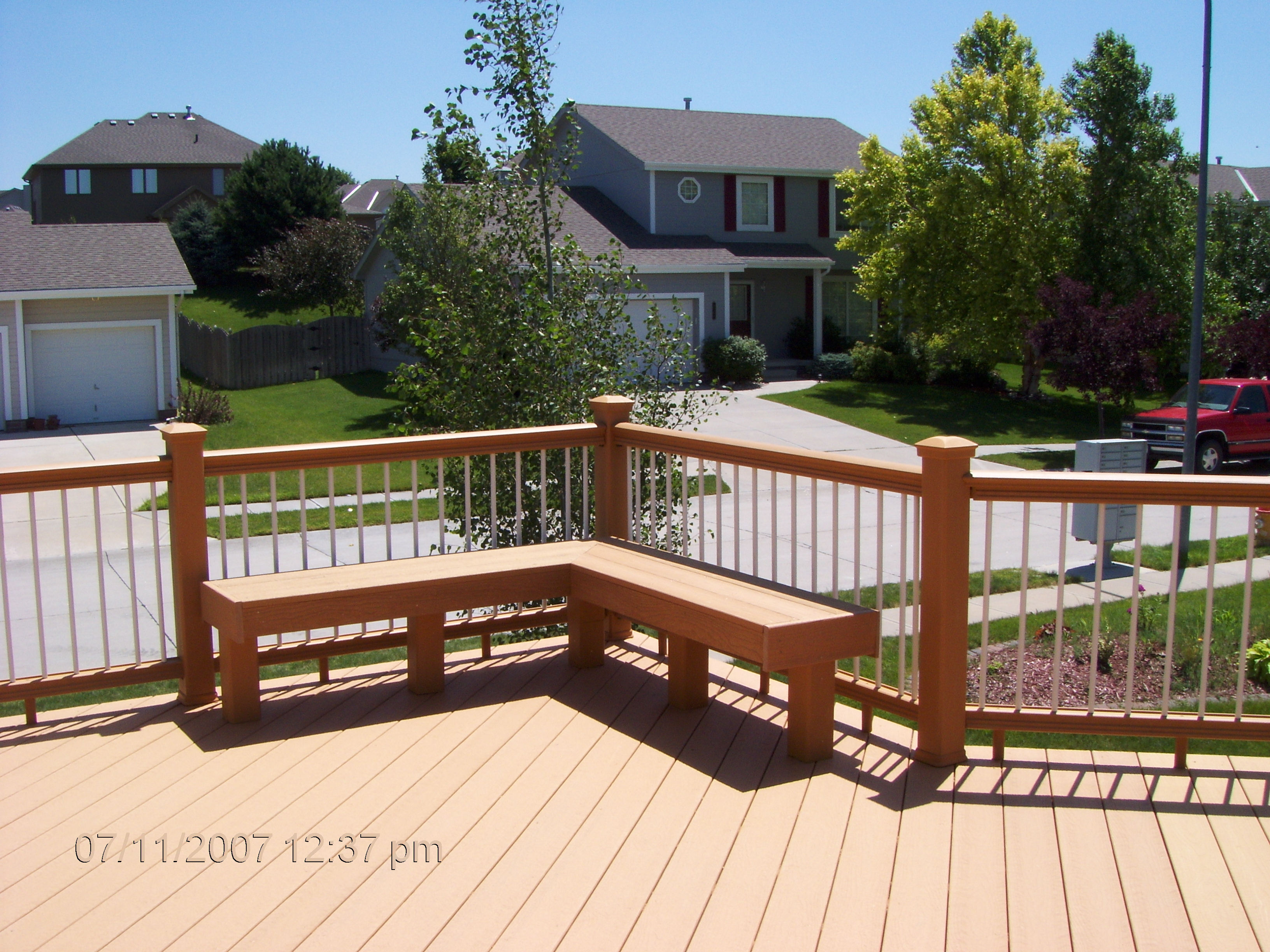 moccasin evergrain decking matched with white and mocca railing plus mocca bench ideas