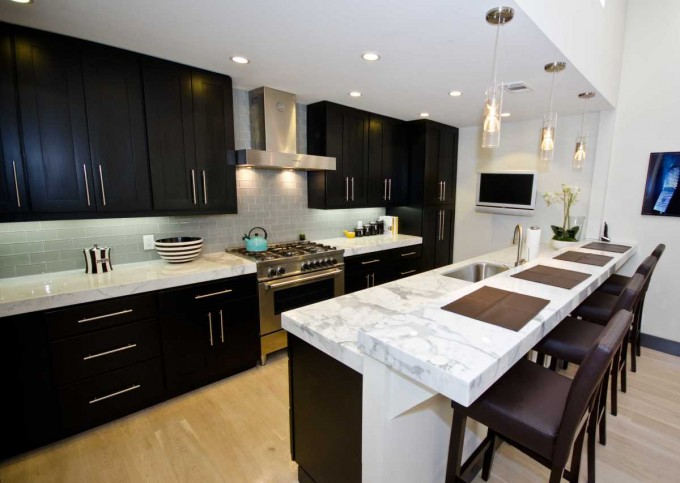 Modern Black Kitchen Cabinet Refacing With White Countertop Plus Silver Oven And Sink With Modern Kitchen Faucets And Modern Dining Table With Chandelier For Modern Kitchen Inspiration