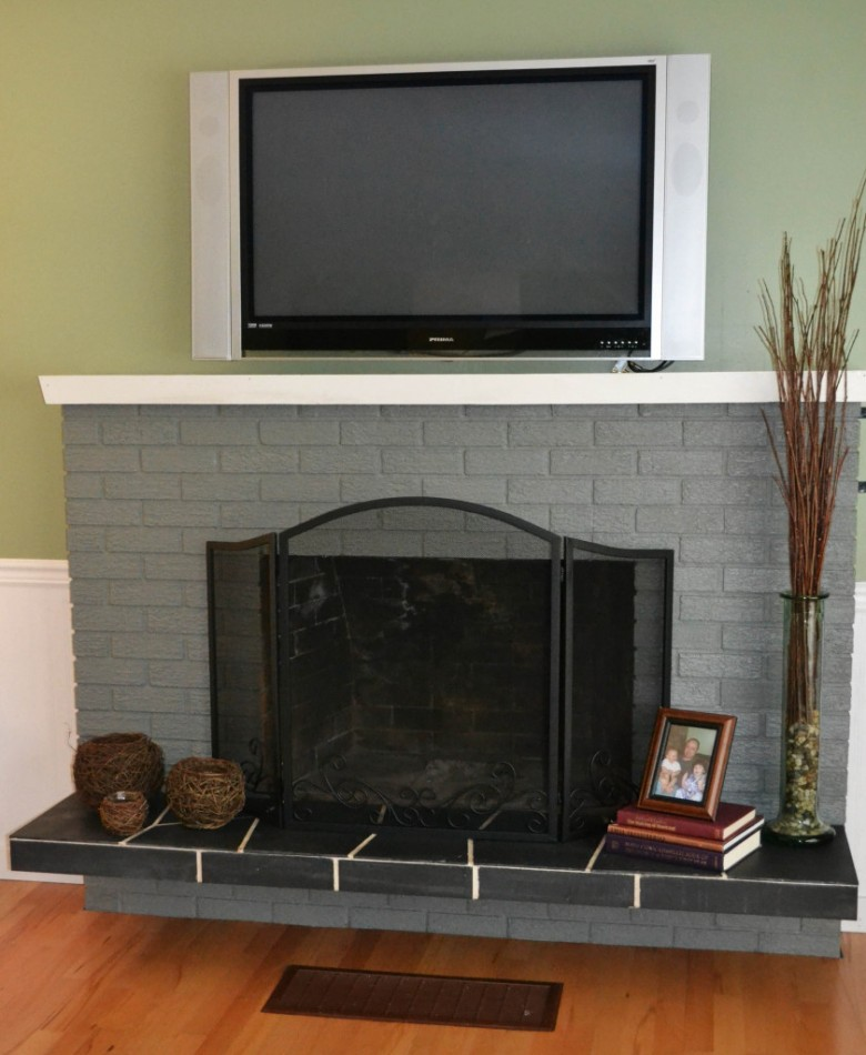 Modern montigo fireplace with grey framw on darkkhaki wall plus dining table ideas