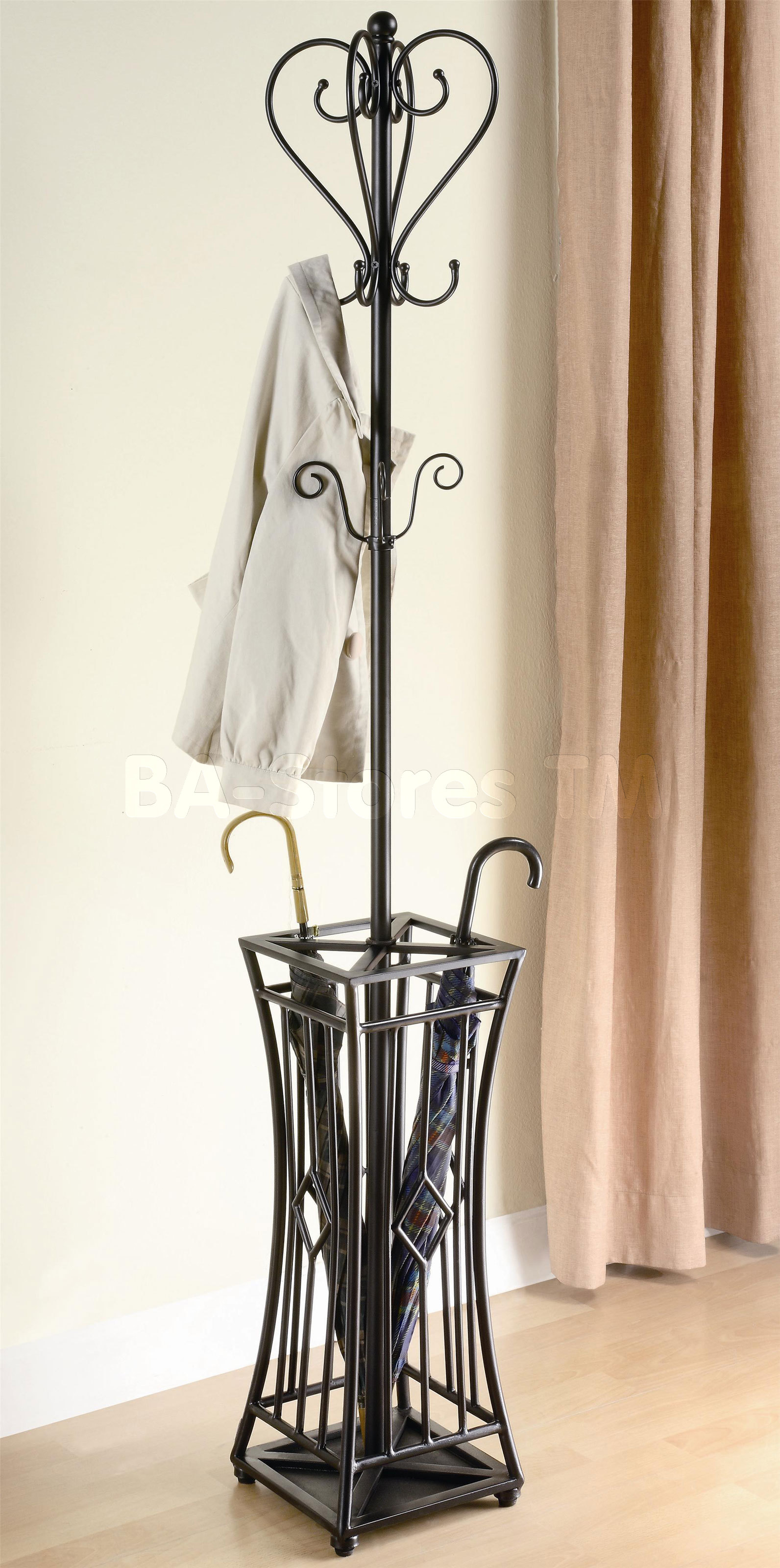 Modern Shape Of standing Coat rack in black with curved hook in a room with cream curtains