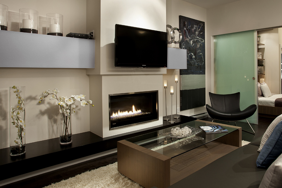 montigo fireplace and tv on white wall with glass table and chair for family room ideas