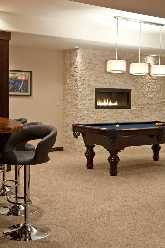 montigo fireplace on white wall plus billiard table plus chandelier and bar table ideas