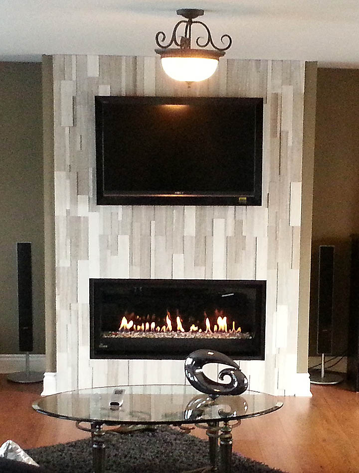 montigo fireplace under tv with glass table on wooden floor with carpet plus chandelier ideas