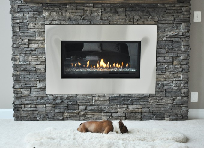 Montigo Fireplace With White Frame On Bricked Wall Plus White Carpet Ideas