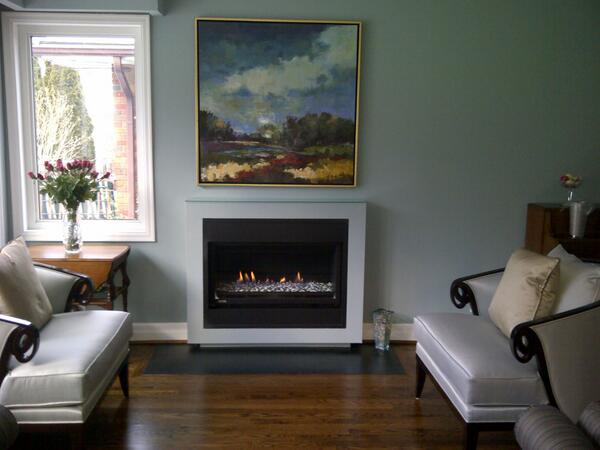 Montigo Fireplaces on darkslategray wall with picture and sofa set on wooden floor ideas