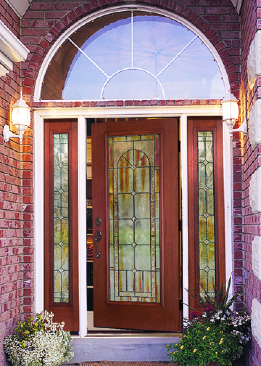 natural brown wood therma tru entry doors with arch and black handlecet handle matched with brick wall plus lamps ideas
