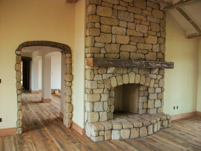 Natural Stone Rumford Fireplace Matched With White Wall And Wooden Floor Ideas
