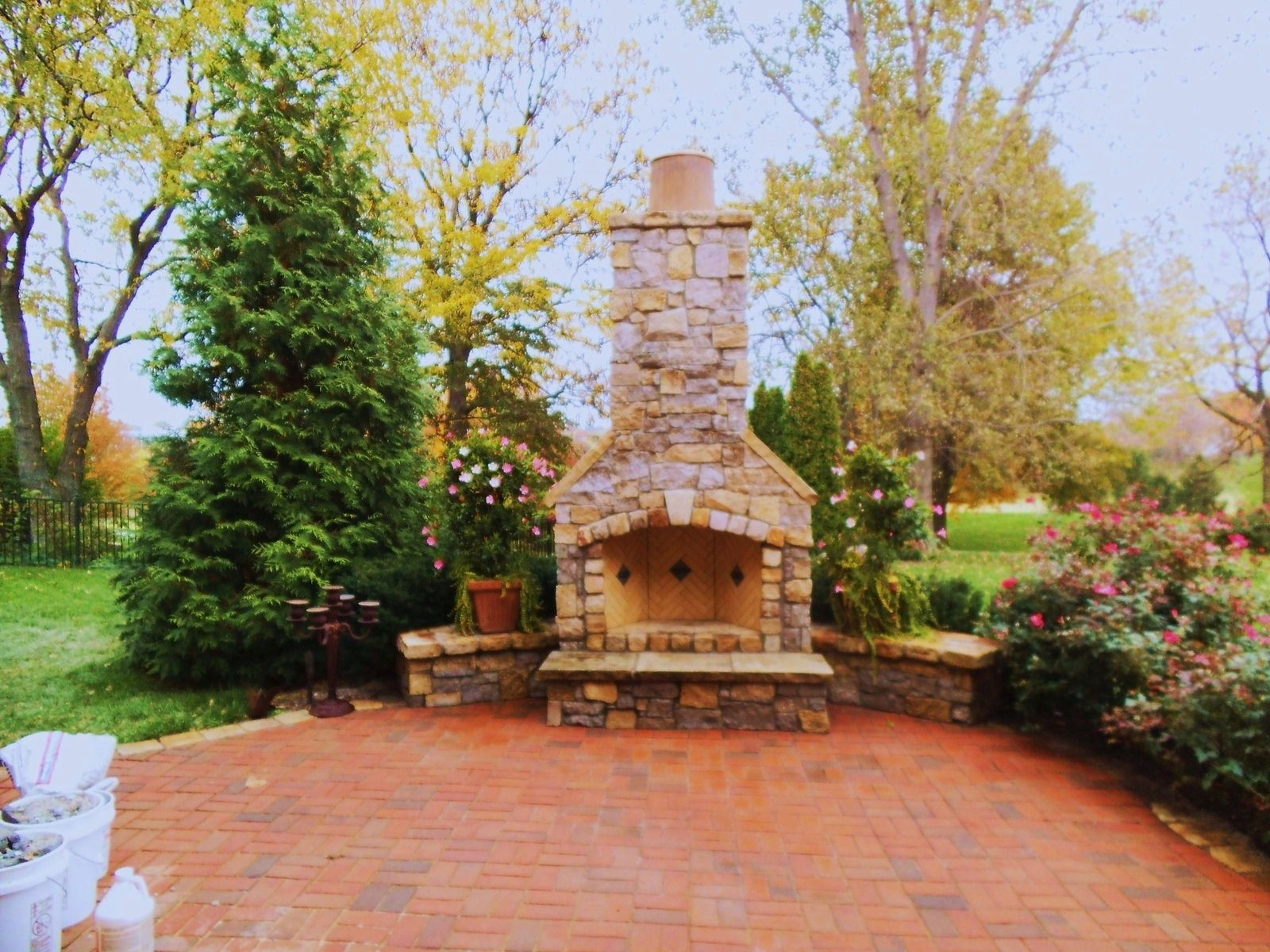 natural stone Rumford fireplace with chimney matched with brown floor for outdoor heat warming ideas