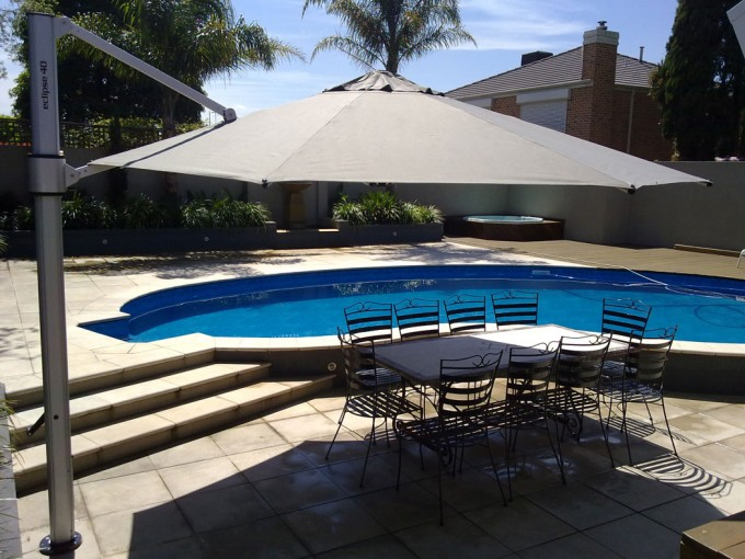 Octagon Eclipse Cantilever Umbrella Plus Dining Table Near The Swimming Pool For Inspiring Patio Decor Ideas
