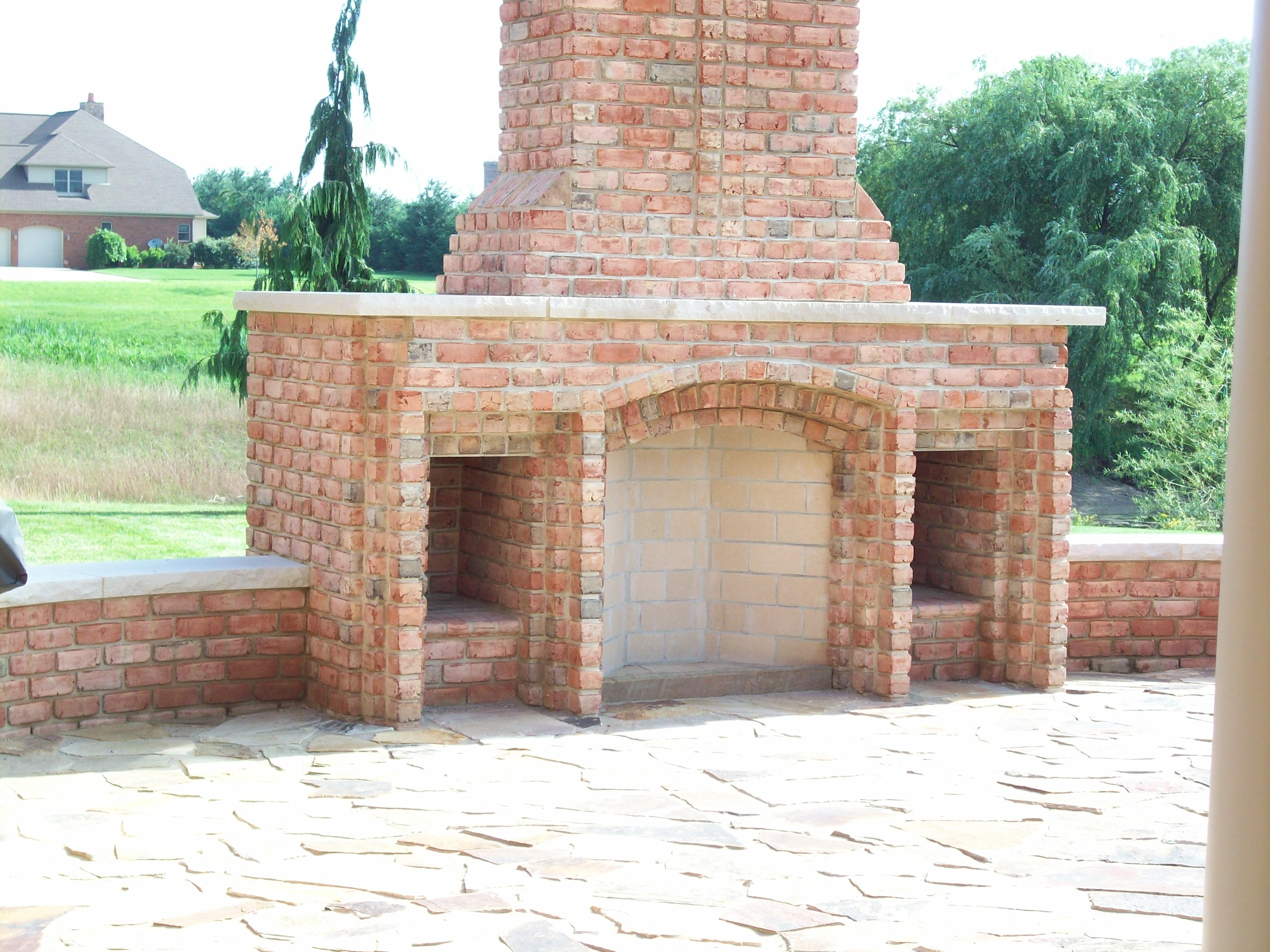 Outdoor brick rumford fireplace with chimney for back ideas