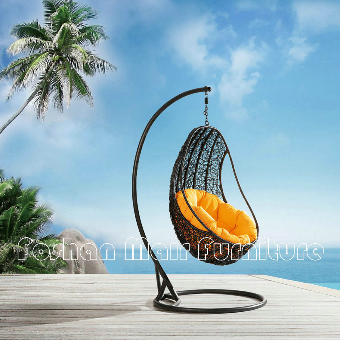 Outdoor brown wicker rattan swingasan chair with yellow cushion and brown metal stand near the beach ideas