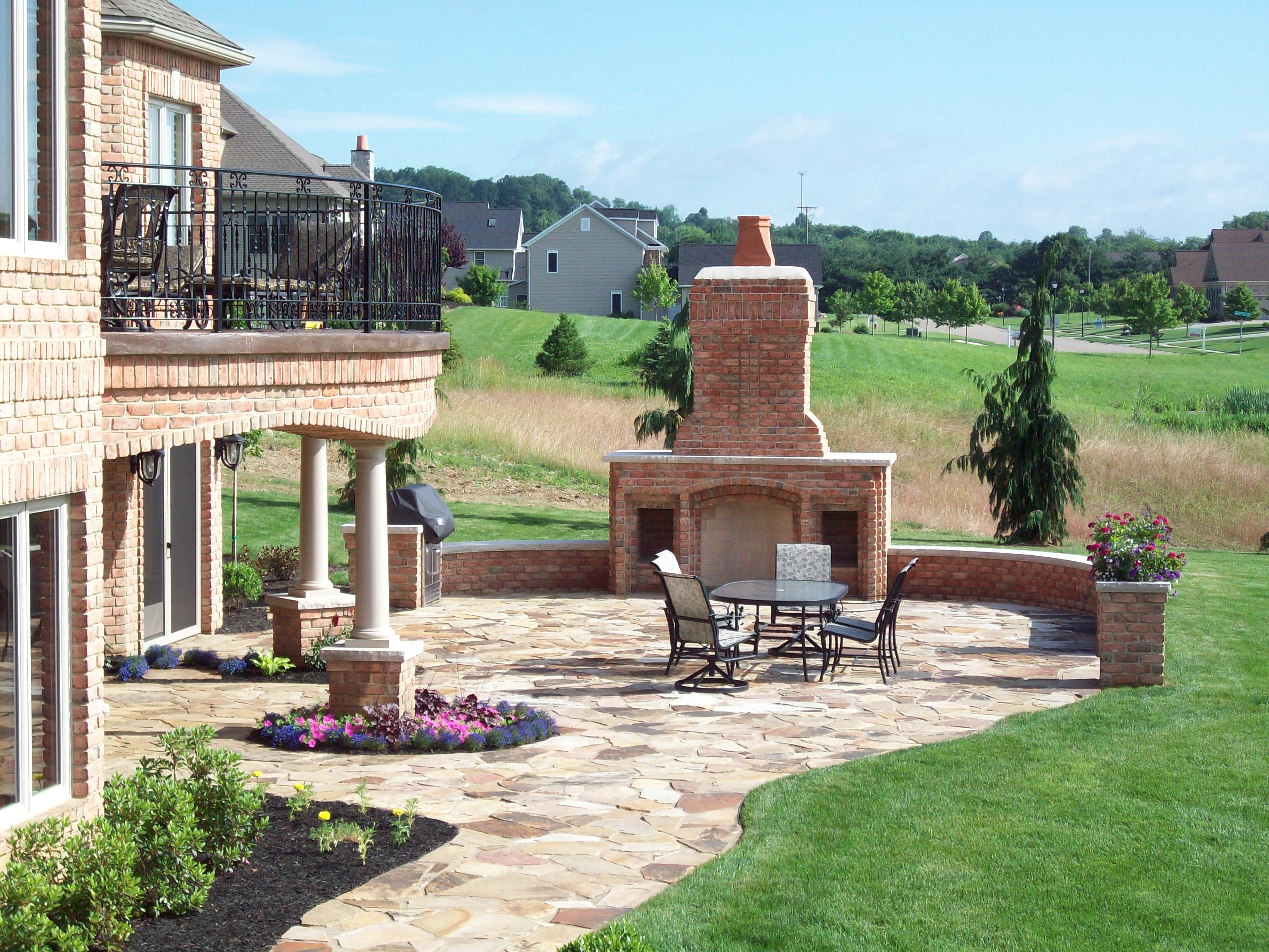 Outdoor Rumford Fireplace with chimney plus dining table outdoor heat warming ideas