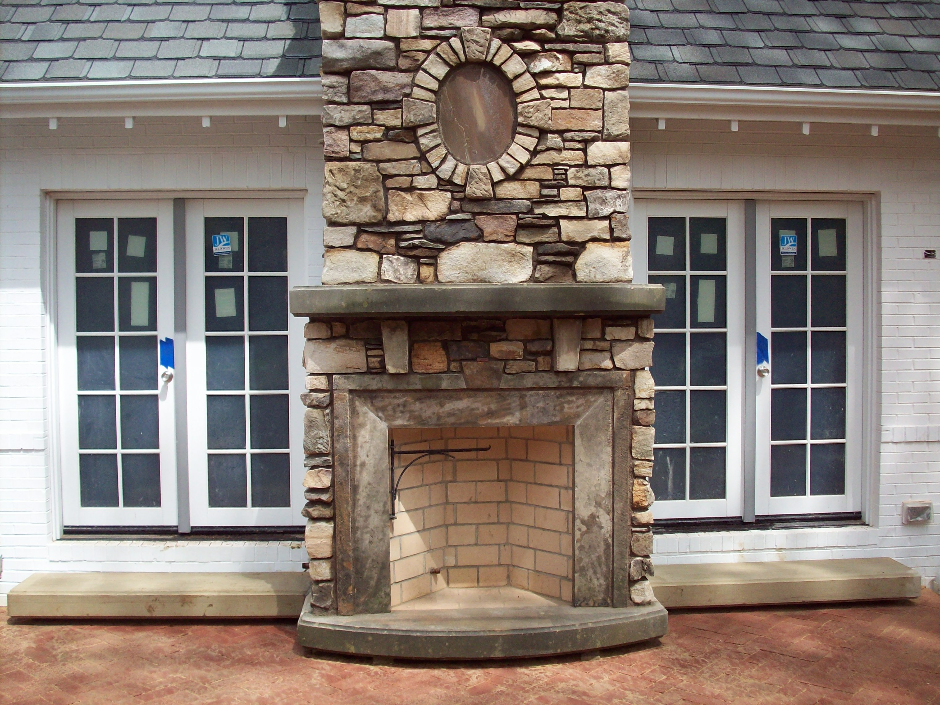 Outdoor Rumford fireplace with natural stone mantel kit matched with brown floor for heat warming patio ideas