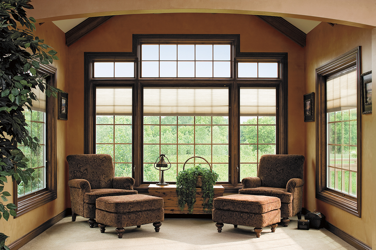 pella windows matched with orange wall plus sofa and white flooring for family room decor ideas