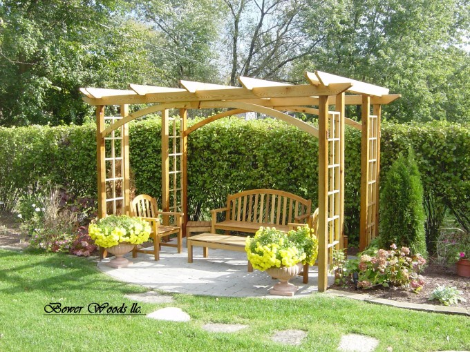 Pergola Plans With Wooden Chairs And Table Plus Flowers On Beautiful Yard