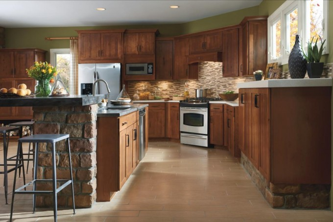 Peru Aristokraft Cabinets With Mocca Tile Back Splash Plus Oven And Frige On Wheat Ceramics Floor For Kitchen Decor Ideas