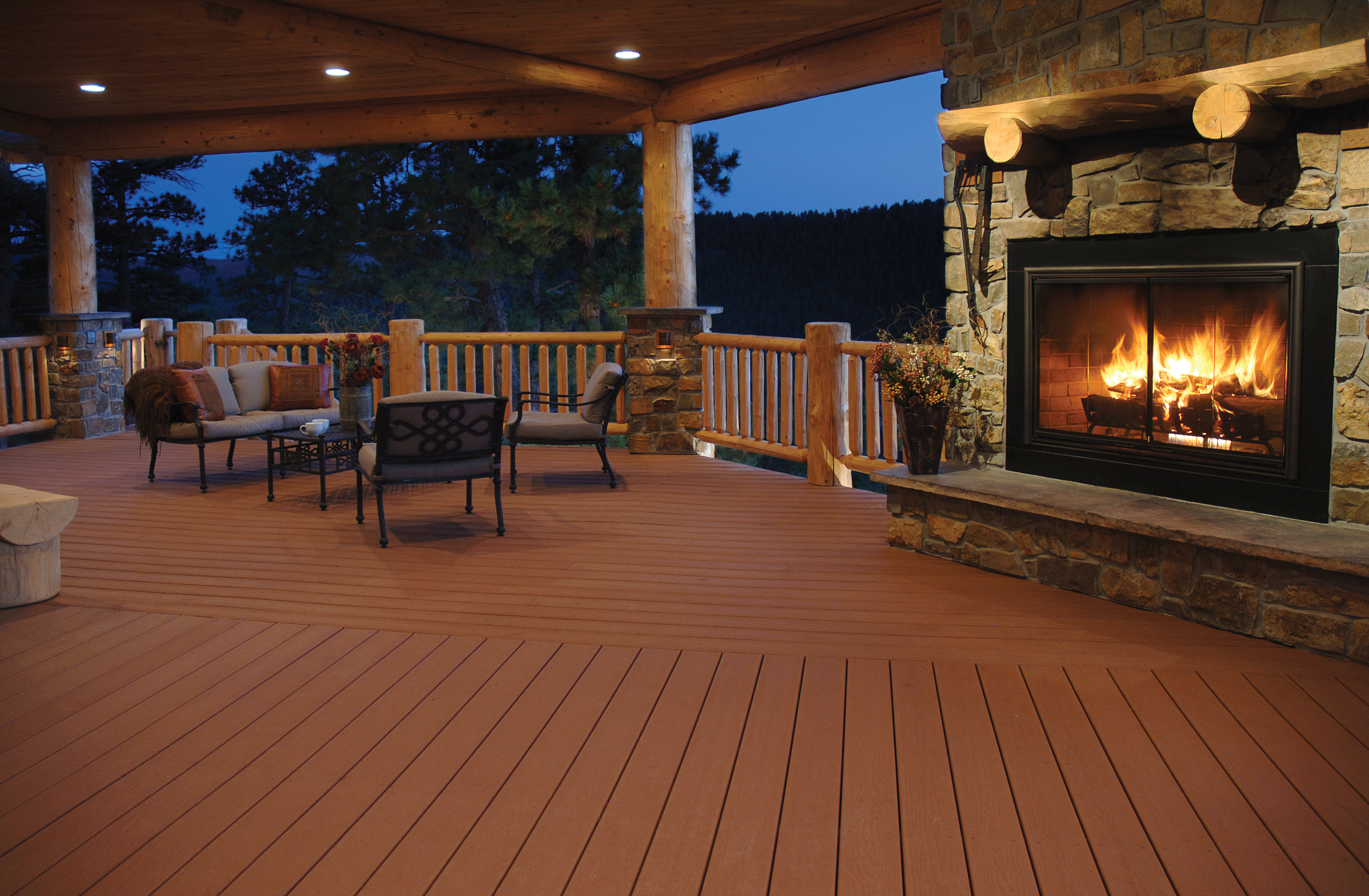 peru evergrain decking matched with cream railing plus sofa set and fireplace for charming patio ideas