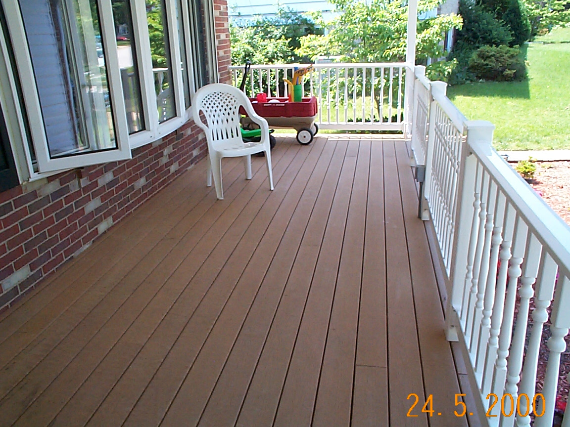 peru evergrain decking matched with white railing plus single white chair for patio decor ideas