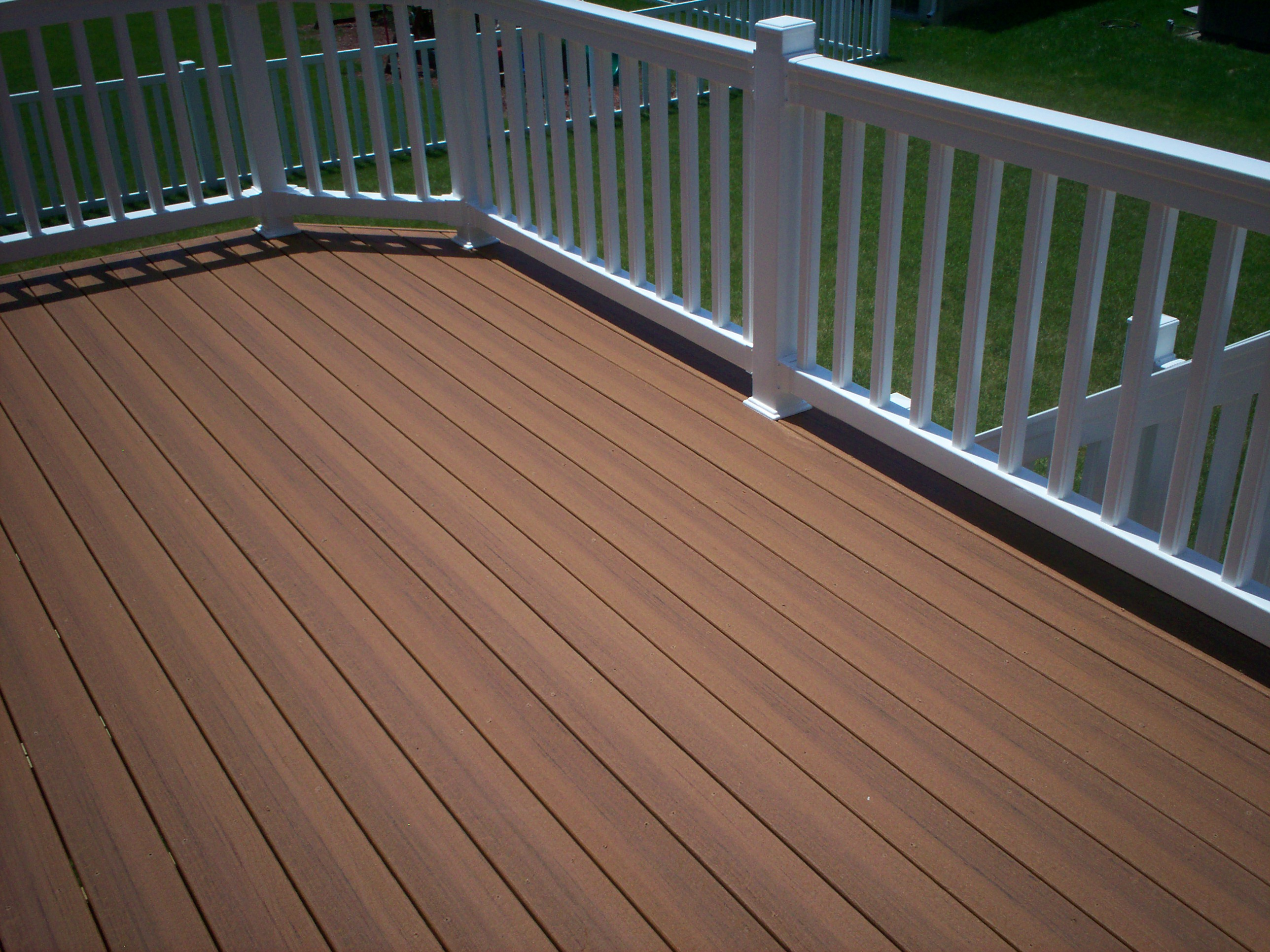 peru evergrain decking plus white railing for patio ideas